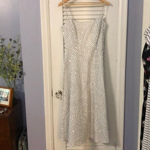 White dress with black-dotted pattern.